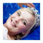 Bride-laughing-on-blue-bouncy-castle-.jpg
