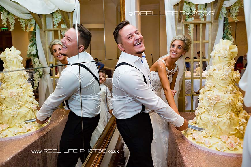 Fun wedding picture of Gypsy wedding cake